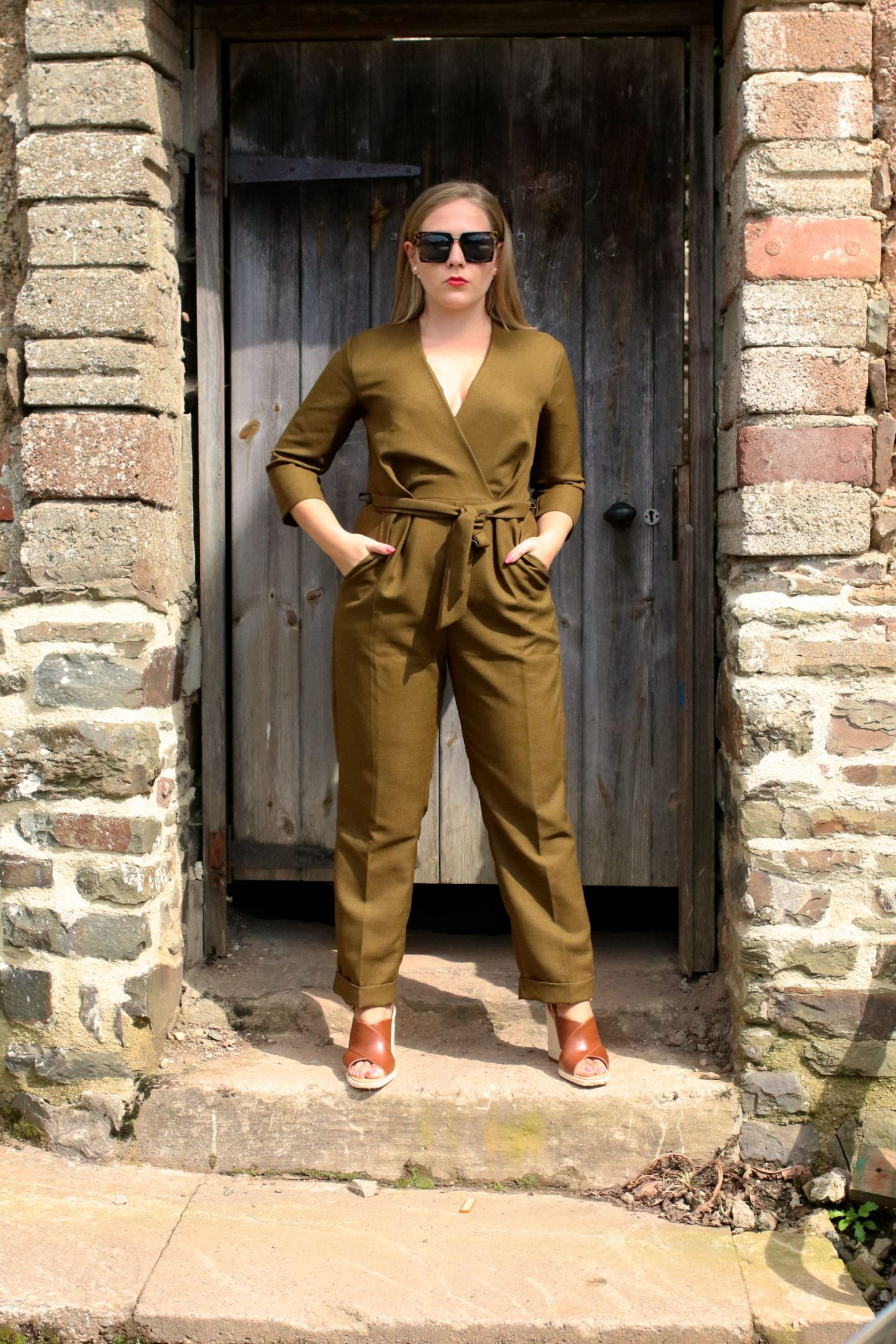 KATIE KALANCHOE wearing Closet London Jumpsuit in Khaki