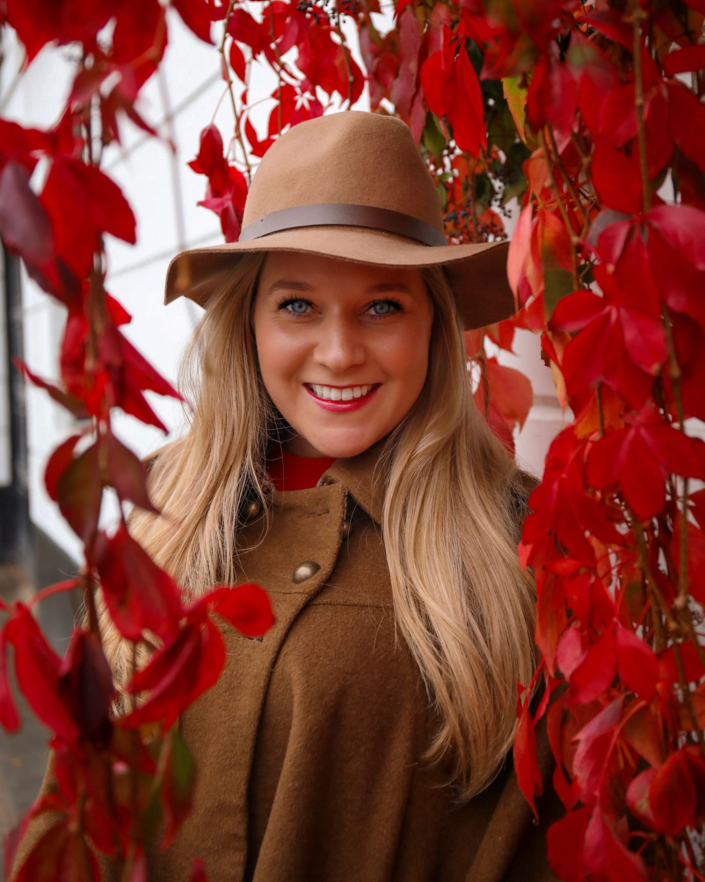 Katie Heath KALANCHOE blonde girl wearing hat and cape at Kynance Mews in Kensington London